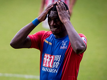 Benteke hands on head